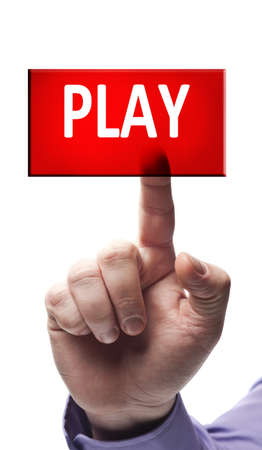 Play button pressed by male hand photo
