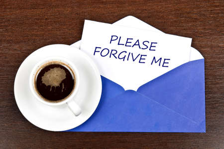 forgive: Please forgive me message and coffee Stock Photo