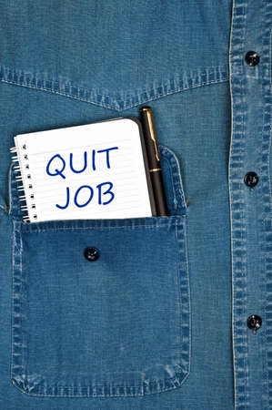 Quit job message on notepad Stock Photo - 9627697