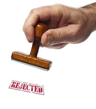 estampa: Rechaz� el sello en mano masculina Foto de archivo