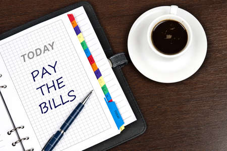 Pay the bills messag on notepad photo