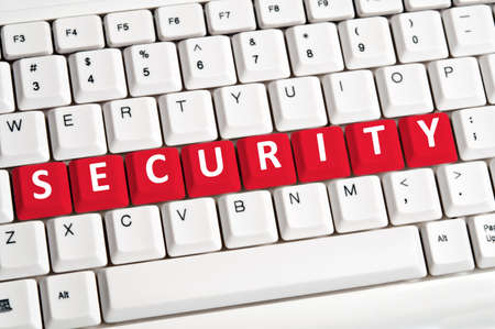 security equipment: Security word on white keyboard Stock Photo