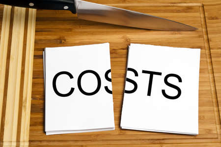 price cutting: Knife cut paper with costs word