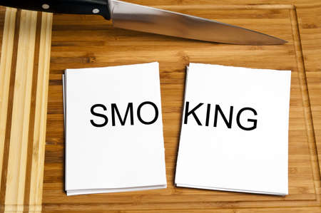 Knife cut paper with smoking word photo
