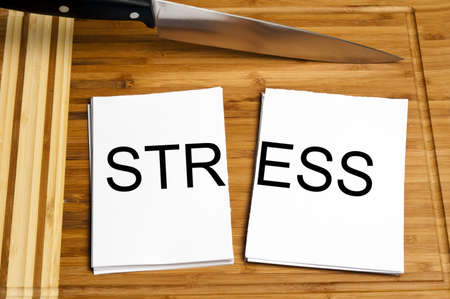 Knife cut paper with stress word Stock Photo - 9627617