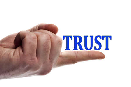 Trust word on male finger photo