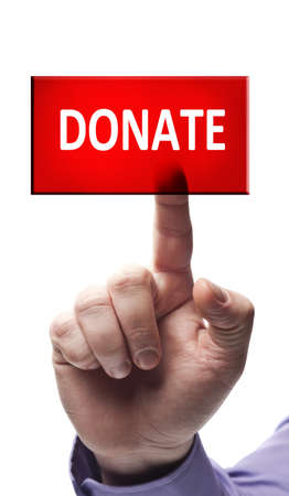 volunteering: Donate button pressed by male hand Stock Photo
