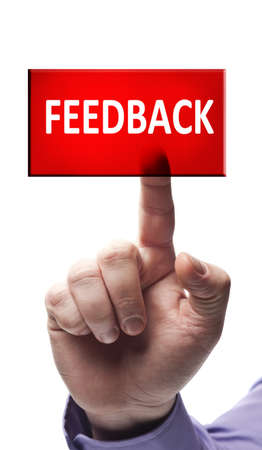 feedback: Feedback button pressed by male hand Stock Photo