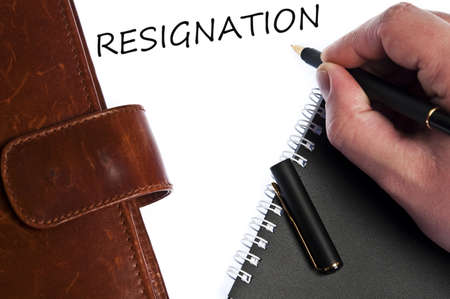 Resignation write by male hand photo
