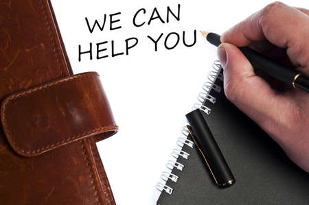 you can: Podemos ayudarle a escribir a mano masculina Foto de archivo