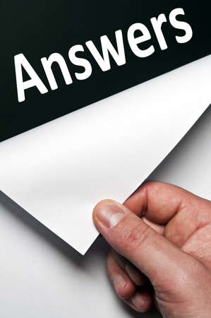 Answers word discovered by male hand Stock Photo - 9627492