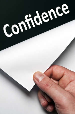 Confidence word discovered by male hand Stock Photo - 9627501