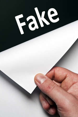 Fake word discovered by male hand Stock Photo - 9627471