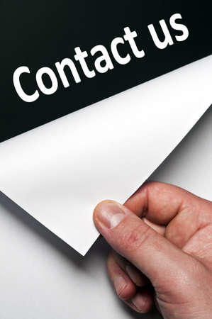secret service: Contact us word discovered by male hand Stock Photo