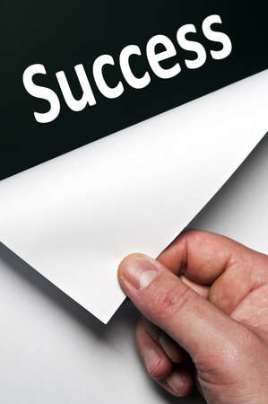 Success word discovered by male hand Stock Photo - 9627478