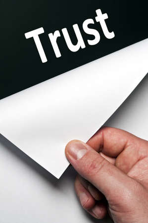 Trust word discovered by male hand photo