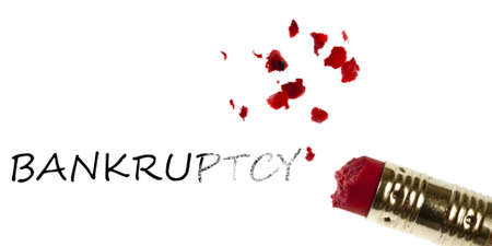 Bankruptcy word erased by pencil eraser photo