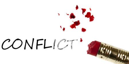 Conflict word erased by pencil eraser photo
