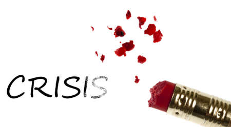 Crisis word erased by pencil eraser photo