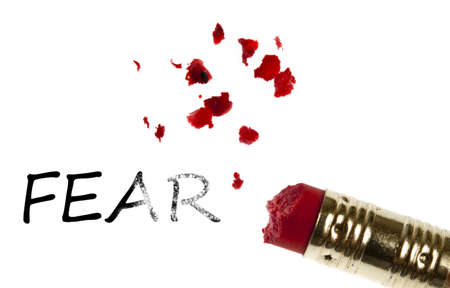 Fear word erased by pencil eraser photo
