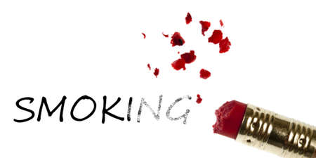 quitting: Smoking word erased by pencil eraser Stock Photo