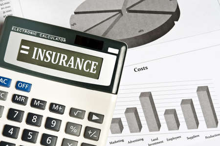 financial insurance: Insurance word on electronic calculator