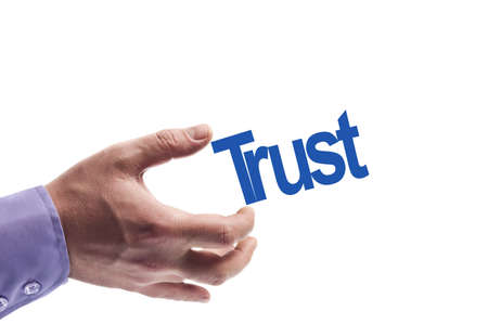 Trust word in male hand Stock Photo - 9627318