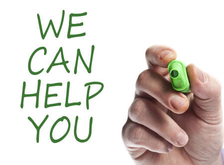 can we help: Hand write with green marker We can help you Stock Photo