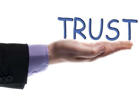 Trust word in male hand Stock Photo - 9628190