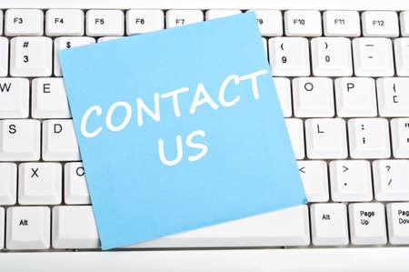 contact info: Contattaci mesage sulla tastiera Archivio Fotografico