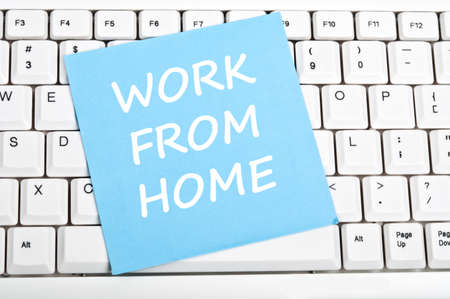 home offices: Work from home mesage on keyboard