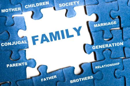 Family blue puzzle pieces assembled Stock Photo - 9628583