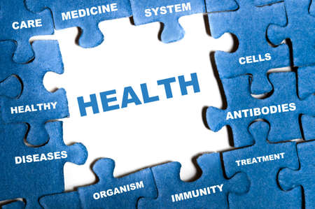 Health blue puzzle pieces assembled Stock Photo - 9628546