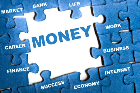 Money blue puzzle pieces assembled Stock Photo - 9628551