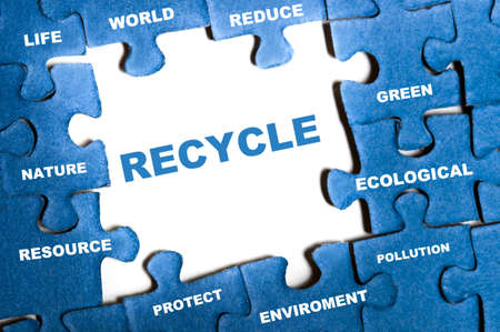 Recycle blue puzzle pieces assembled Stock Photo - 9628549