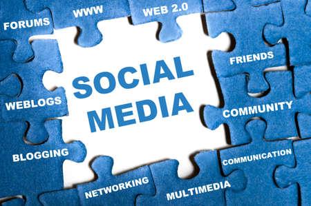 press media: Social media blue puzzle pieces assembled Stock Photo