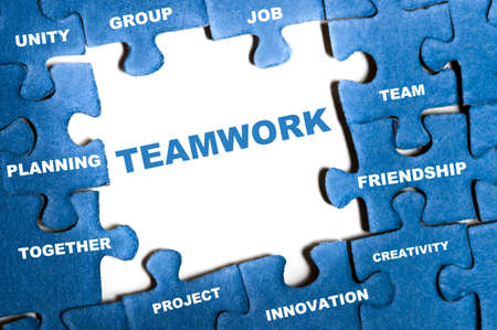 Teamwork blue puzzle pieces assembled photo