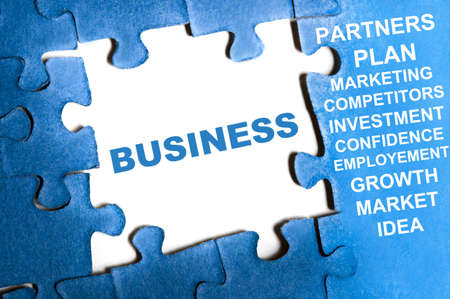 Business blue puzzle pieces assembled Stock Photo - 9628782