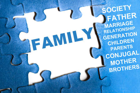Family blue puzzle pieces assembled Stock Photo - 9628780