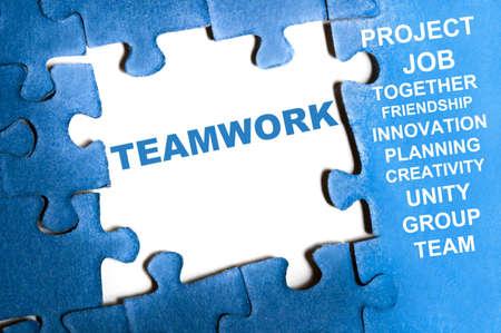 Teamwork blue puzzle pieces assembled Stock Photo - 9628554