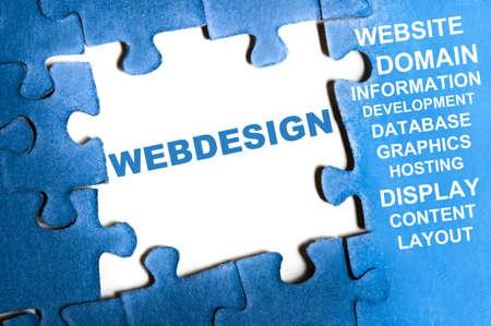 website words: Webdesign blue puzzle pieces assembled Stock Photo
