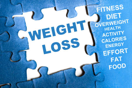 fat loss: Weight loss blue puzzle pieces assembled