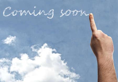 soon: Coming soon word on blue sky