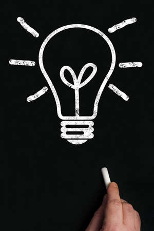 Bulb write on black board Stock Photo - 9628319