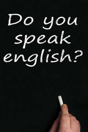 Do you speak english? write on black board Stock Photo - 9628351