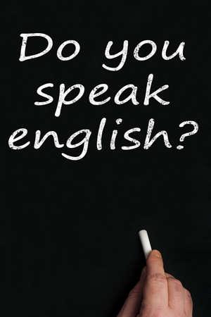 Do you speak english? write on black board Stock Photo - 9628351