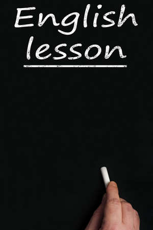 learn english: English lesson write on black board