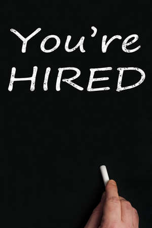 You're hired write on black board Stock Photo - 9628256