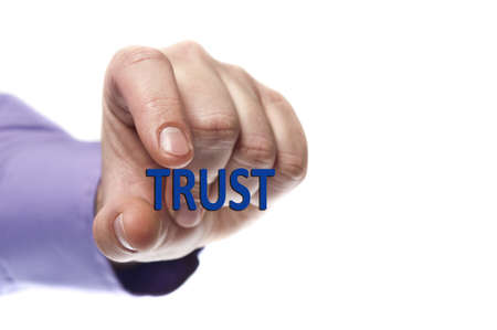 Trust word in male hand Stock Photo - 9627737