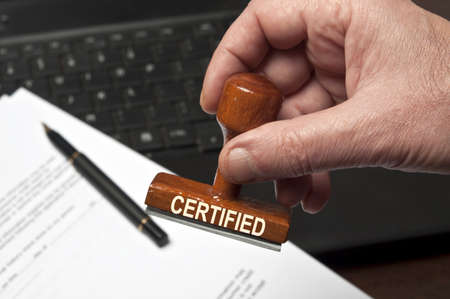 Certified stamp in male hand
